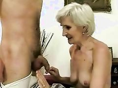 Hot mature enjoys sex with a boy