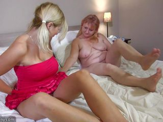 blonde doxy playing with an old woman-on-woman