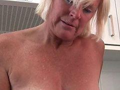 Granny in perceive through white pants masturbates
