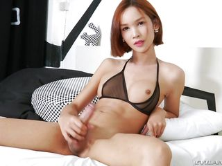 skinny ladyboy plays with her beautiful stick