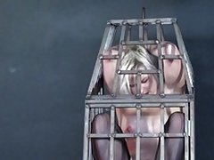 Caged blonde youngster submissive  Miss Chaos whipped and hotwaxed in her hanging metal prison
