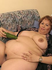 Big woman with cucumber