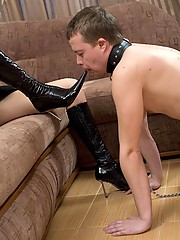 Smoking bitch in high black latex boots humiliates her slave and puts her cig out against his lips