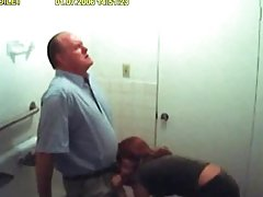 Lucky old fart gets his cock blown by a lovely red haired babe