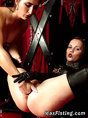 Two kinky lesbians enjoying BDSM and fisting action here