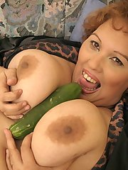 Huge slut with cucumber