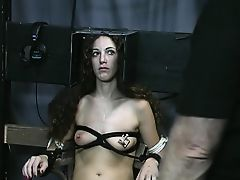 Elegant brunette is bound, takes nipple torture in the dungeon