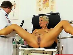 Blondes MILF gyno in addition to a little extra